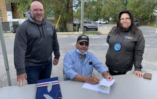 Erik Holmstrom Vice President of Miitigoog (left), Wabauskang Chief Bill Petiquan (middle), Miitigoog President Lorraine Cobiness (right), signing the agreement welcoming Wabauskang to the partnership.